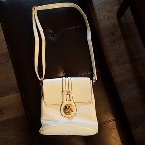 Very cute white woth black trim purse